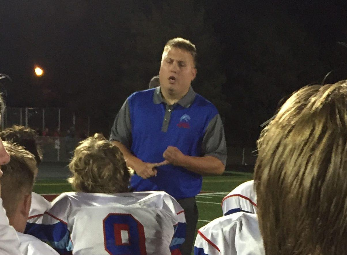 Corey Black talks to his team during a game. Black has been a part of the Albert Lea football program for years before becoming head coach.