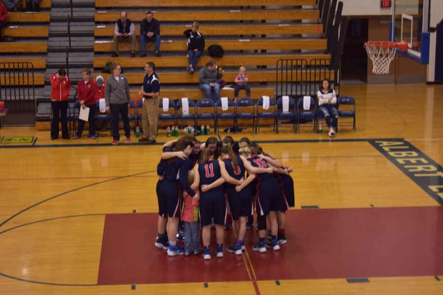 The+team+huddles+to+discuss+plans+and+encourages+one+another+before+the+game.+The+girls+played+Mankato+East+on+Feb+11th