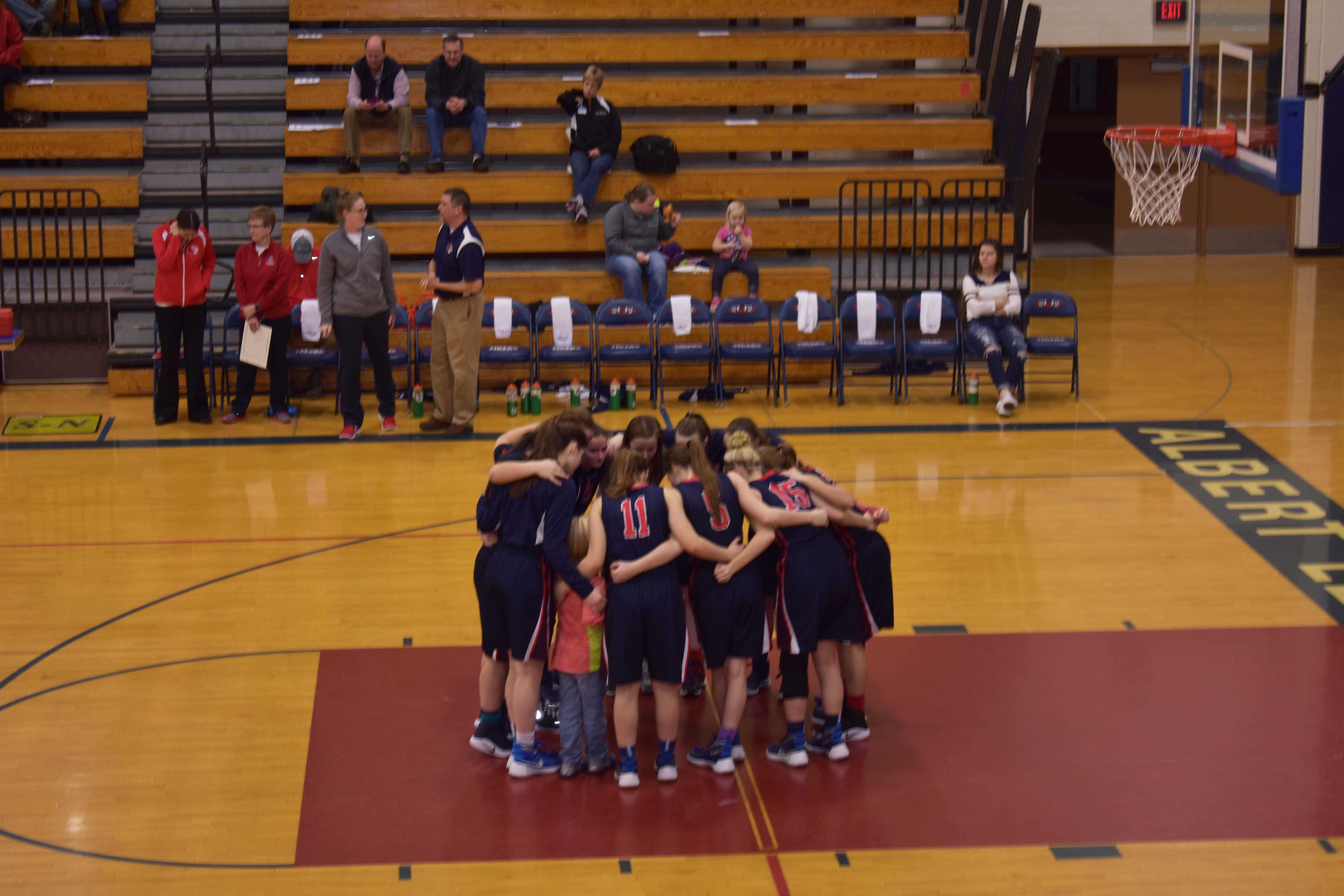 The team huddles to discuss plans and encourages one another before the game. The girls played Mankato East on Feb 11th