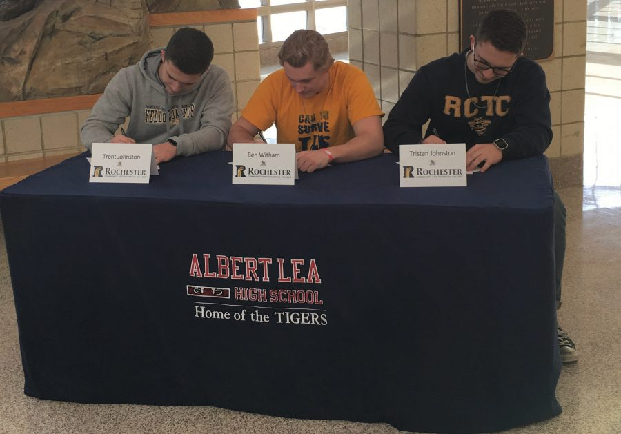 Seniors+Trent+Johnston%2C+Benjamin+Witham+and+Tristan+Johnston+sign+their+letters+of+intent+to+play+football+at+Rochester+Community+and+Technical+College+in+Rochester.+The+boys+have+been+playing+football+for+many+years+for+the+Albert+Lea+Tigers.+Photo+Submitted