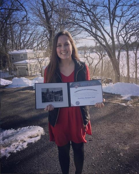 Maddy+Funk+holding+her+certificate+of+appointment+to+the+United+States+Military+Academy.+She+received+her+acceptance+letter+in+February.+%E2%80%9CAll+of+my+hard+work+has+paid+off.%E2%80%9D+Funk+said.+Photo+Submitted