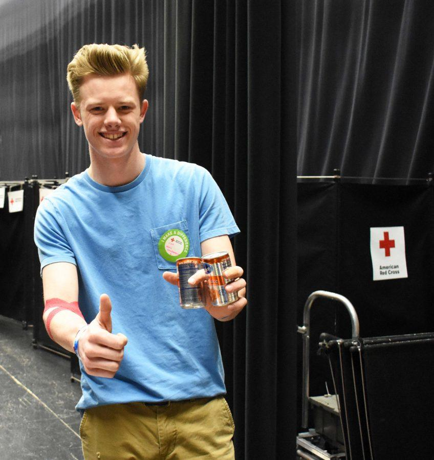 Alexander+Goodmanson+%2811%29+receives+cans+of+juice+after+donating+blood.+