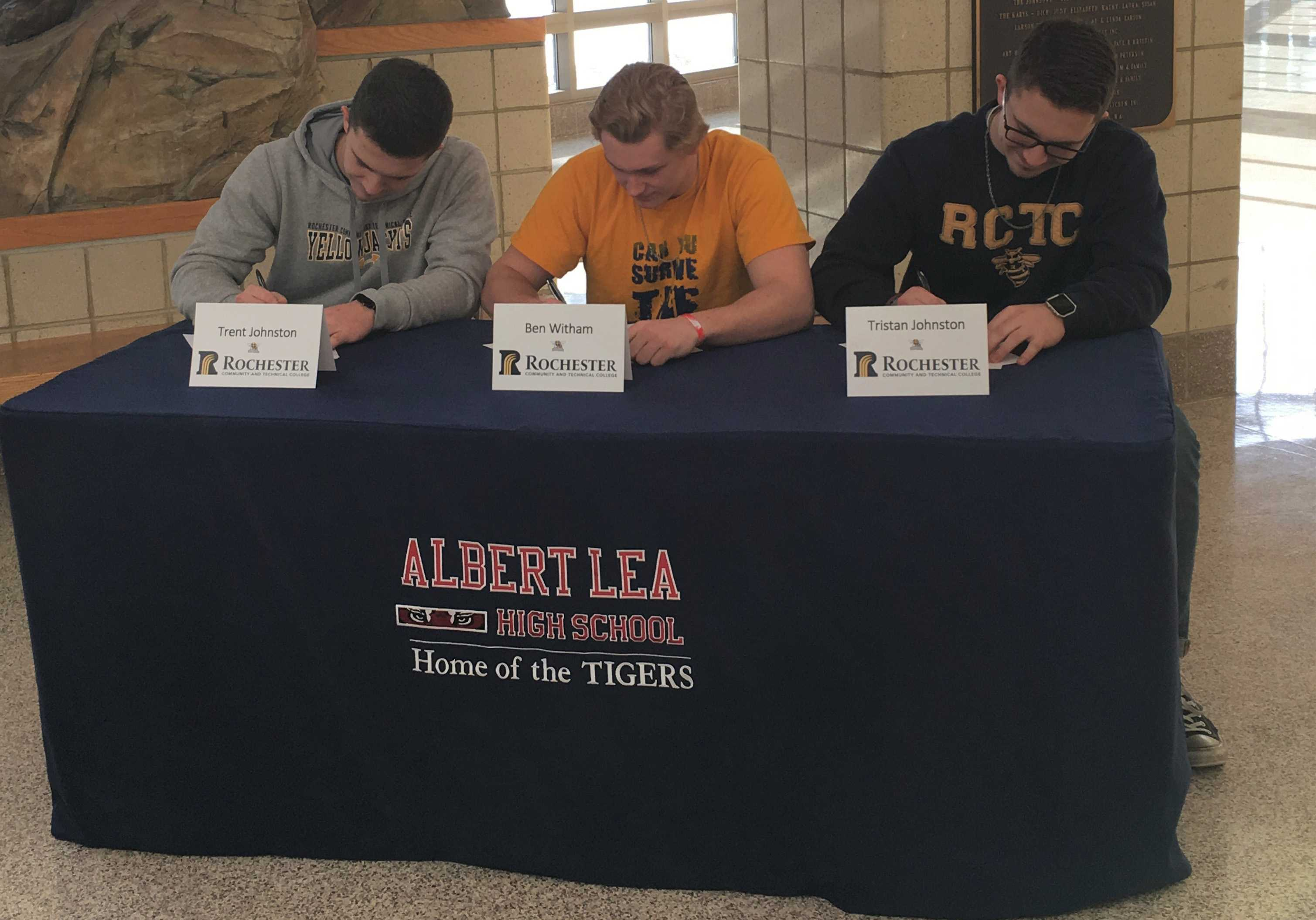 Seniors Trent Johnston, Benjamin Witham and Tristan Johnston sign their letters of intent to play football at Rochester Community and Technical College in Rochester. The boys have been playing football for many years for the Albert Lea Tigers. Photo Submitted