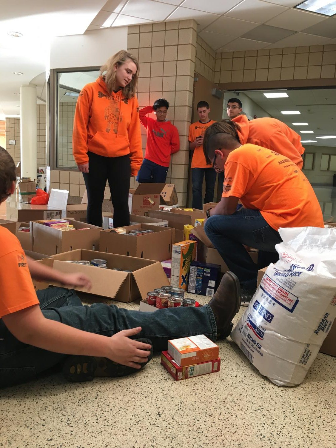"The Robotics Team loading the donated food to the Salvation Army's truck. Student Council collected food from classrooms every other day.  ""I had a lot of fun and it was for a good cause,"" said senior Andrew Huerta Ortiz, a member of the robotics team."