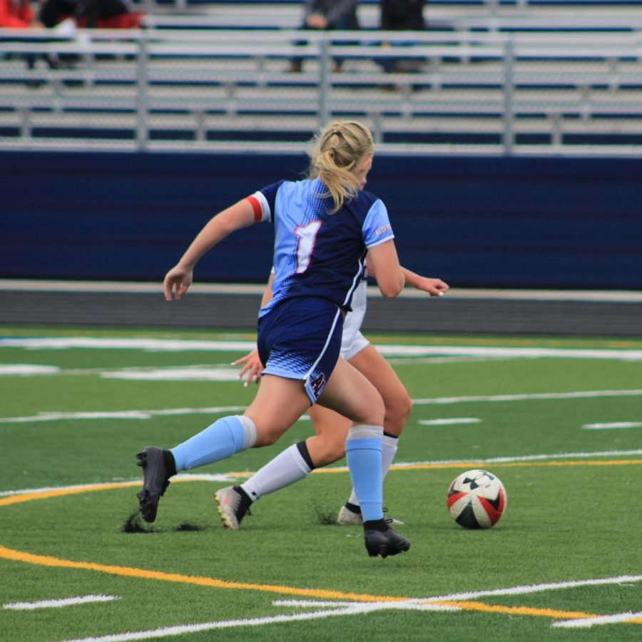 Senior+Maddie+Schneider+is+a+captain+on+the+girls%27+varsity+soccer+team+with+aspirations+of+playing+college+soccer.+Before+the+season+was+halted%2C+a+college+scout+was+planning+on+attending+the+Sept.+18+game+against+Owatonna+to+possibly+recruit+her.+%22Missing+the+game+against+Owatonna+will+affect+me+because+the+scout+was+there+to+watch+me+play+and+see+how+I+am+as+a+player%2C%22+Schneider+said.+%22If+I+met+requirements%2C+I+would+have+a+spot+on+that+college+team.%22