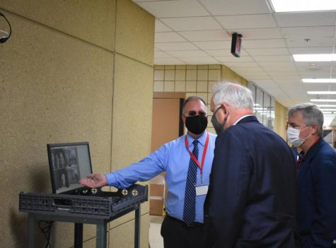 "ALHS Principal Mark Grossklaus and Superintendent Mike Funk show Minnesota Governor Tim Walz the thermal scanners inside of the building. The scanners were installed as a safety precaution that was taken in order to prevent the spread of COVID-19 among the students and staff. ""Our hope is that what"