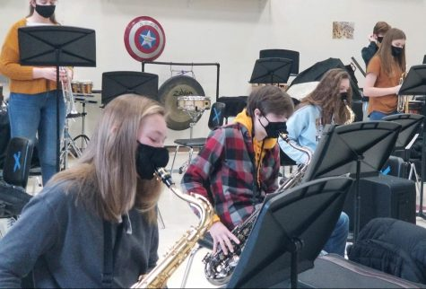 "The Albert Lea Jazz Band practices Monday and Thursday mornings. The saxophonists were lined up and as they rehearsed some of their music. ""Going into it I was looking for something that would challenge me and be a great experience, and Jazz Band is just that,"" said Nevaeh Wacholz, an eighth grade saxophone player."