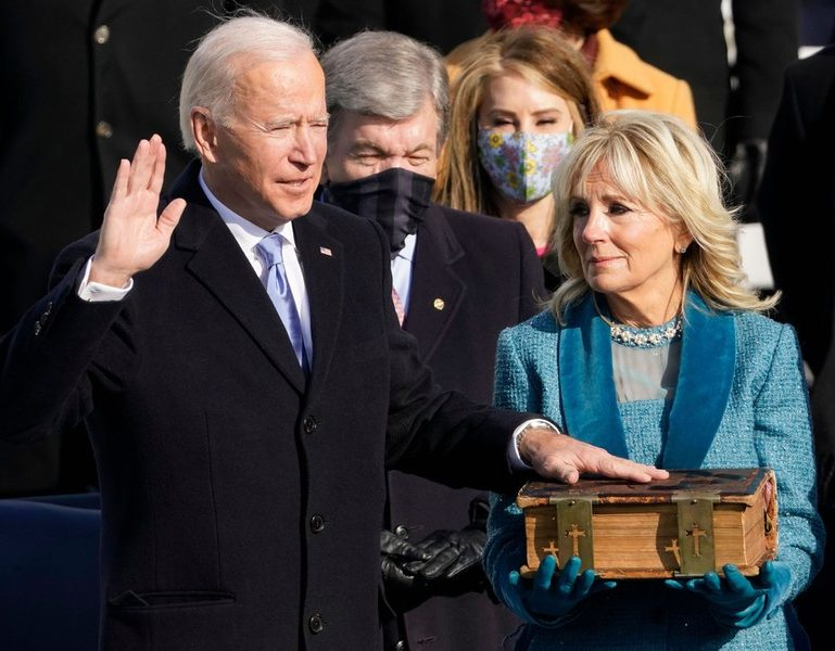 "President Joe Biden placing a hand on a historic family bible as he is sworn in to office. Many Americans watched on as TV screens showed the Jan 20 inauguration and the speeches that took place. ""With unity we can do great things, Important things,"" said President Biden. ""We can right wrongs."""