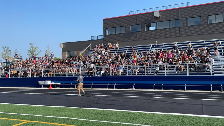 Math teacher Kevin Gentz speaks to the crowd of eighth graders and Link Leaders. The Link Crew event began at the stadium and shifted to the high school as the day progressed.