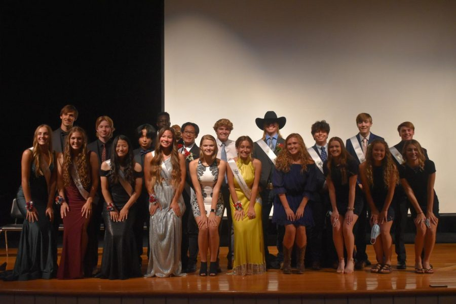 The 2021 Homecoming Court and their escorts pose for a picture after coronation.   Back row: Jack Doppelhammer, Mason Buendorf, Shine Thu, Garang Dual, King Leon Kong, Cameron Davis, Cole Janssen, Jared Turrubiartes, Henrik Lange, Carter Miller  Front row: Taya Jeffrey, Abby Chalmers, Esther Yoon, Queen Lucy Stay, Hailey Strom, Vayda Stadheim, Leah Rognes, Lauren Brownlow, Malana Thompson, Olivia Boyce