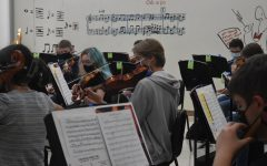 Students in the Symphony Orchestra practice their music during class. This orchestra is one of the many electives available to students, while the chamber orchestra is an extracurricular available to musicians looking for an opportunity to play more advanced music.